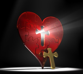 Red heart puzzle with a gold cross as the missing center piece under a spotlight on a dark background